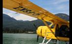 Open Yellow Seaplane Floating On Lake