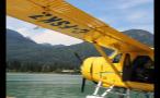 Open Yellow Seaplane Floating On Lake 2