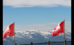 Snow Capped Mountains Behind Waving Flags
