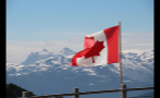 Waving Canadian Flag By Mountains
