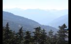 Glowing Haze Behind Forest Mountain Landscape