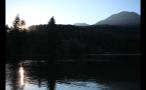 Sun Going Down Past Lake