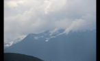 Clouds Covering Snowy Mountains