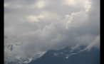 Clouds Sweeping Across Mountain Range