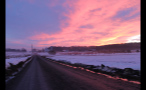 Brightly Colored Sky at Sunset Over Snow Covered Farm
