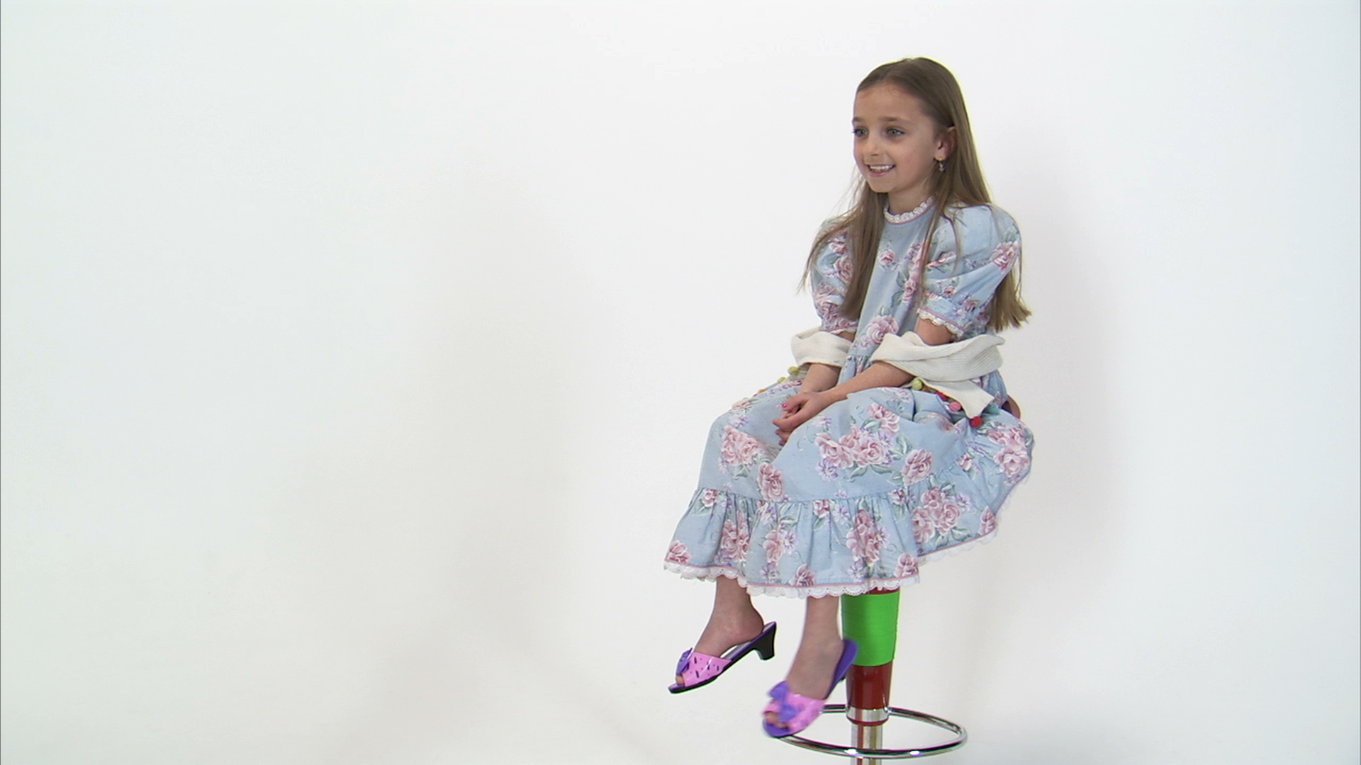 Little Girl Playing On Tall Chair And Kicking Off Shoes