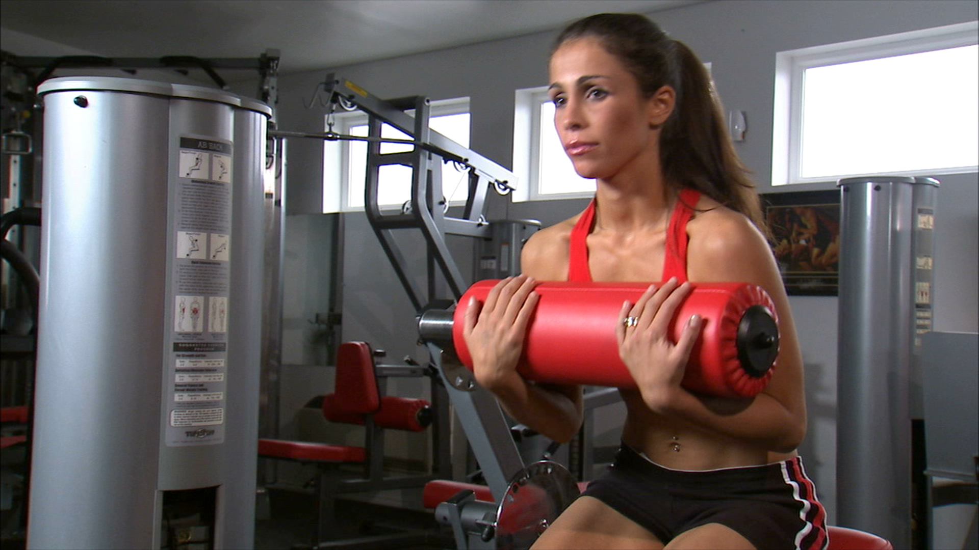 Woman doing ab workout in gym weight room unlimited