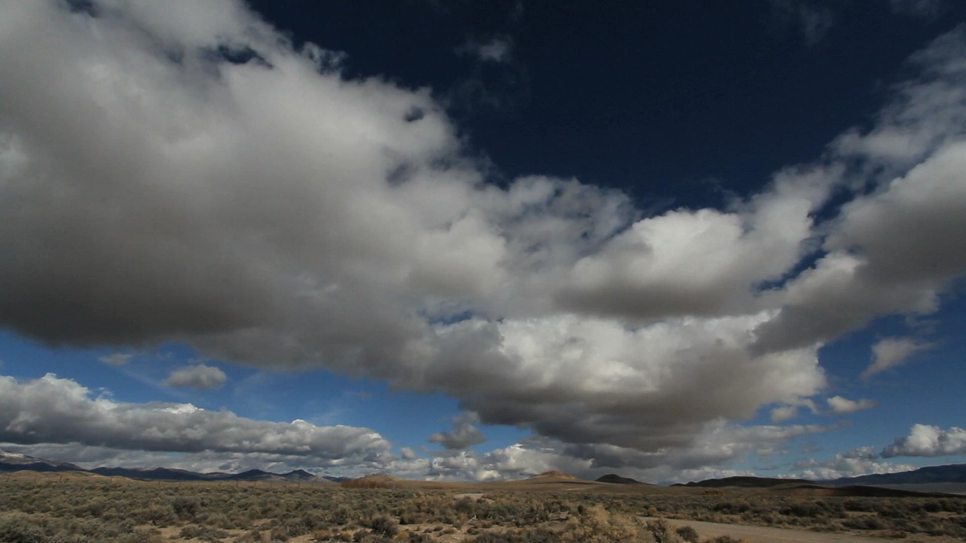 Low Clouds Rolling Across Barren Landscape 2 Unlimited