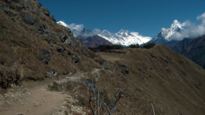 Trekking Path in Nepal with Himalayan Peaks