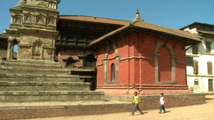 Young Nepali Children Walk Past Old Temple