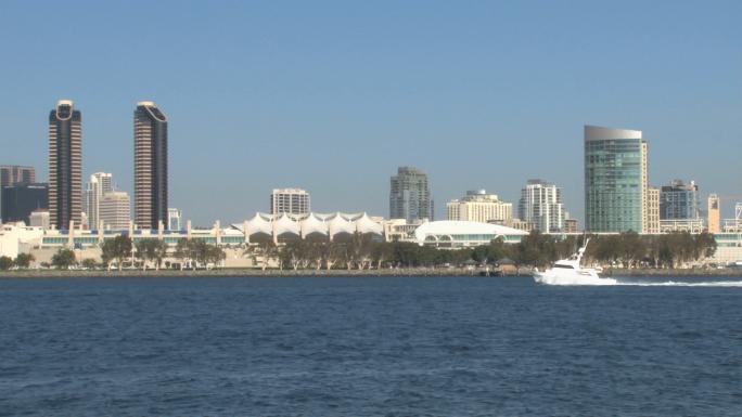 San Diego Harbor Small Yacht Sails through Skyline in Distance