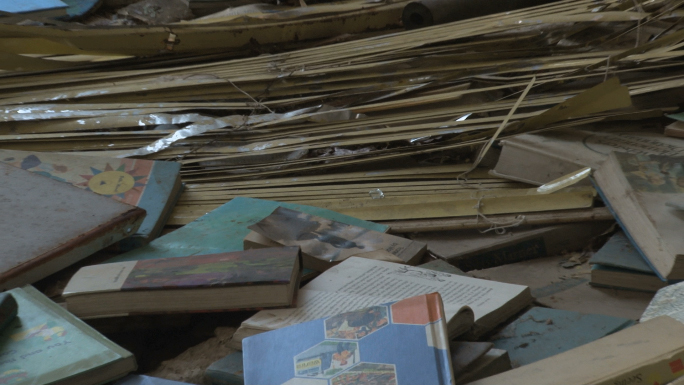 Zoom out room covered with old, abandoned books.