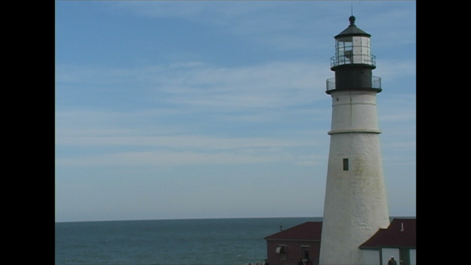 White Lighthouse and Ocean Horizon