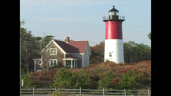 Red Striped Lighthouse and House