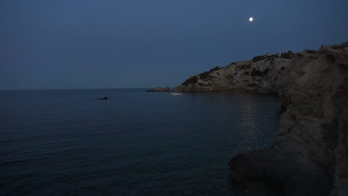 Lonely Boat in Water with Moon in Night Sky 3