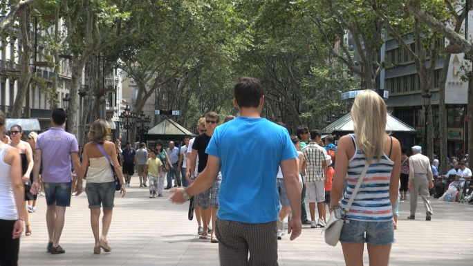 Crowd of People Under Tree Canopy in Barcelona Spain 2