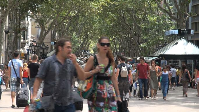 Crowd of People Under Tree Canopy in Barcelona Spain 3