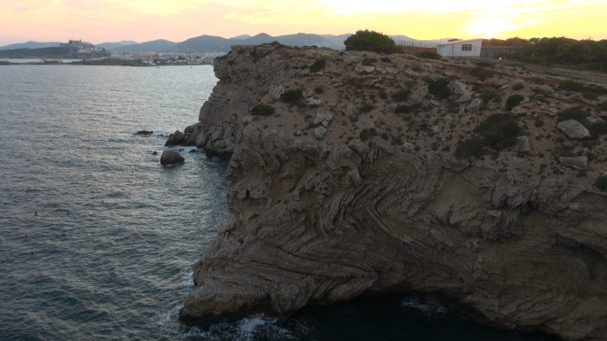 Warm Colored Sky and Rock Formation Near Water 4