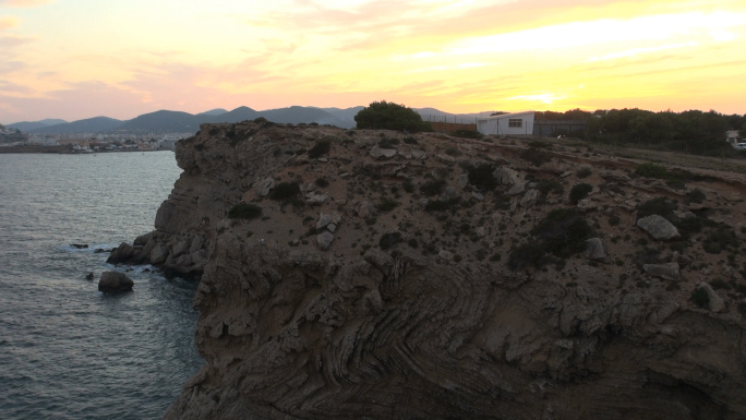 Warm Colored Sky and Rock Formation Near Water 5