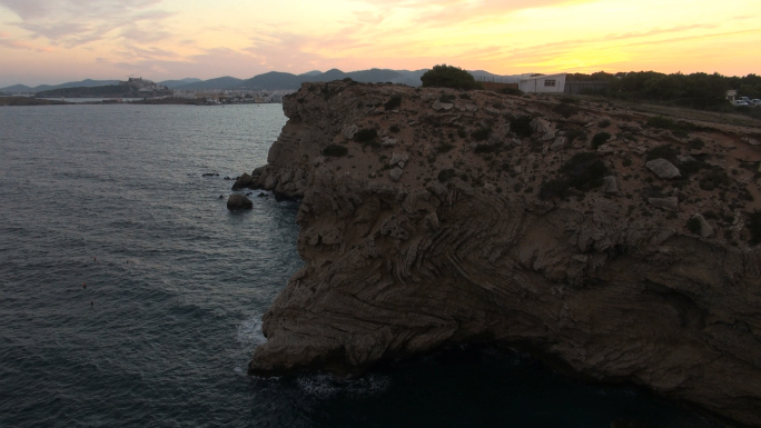 Warm Colored Sky and Rock Formation Near Water 7