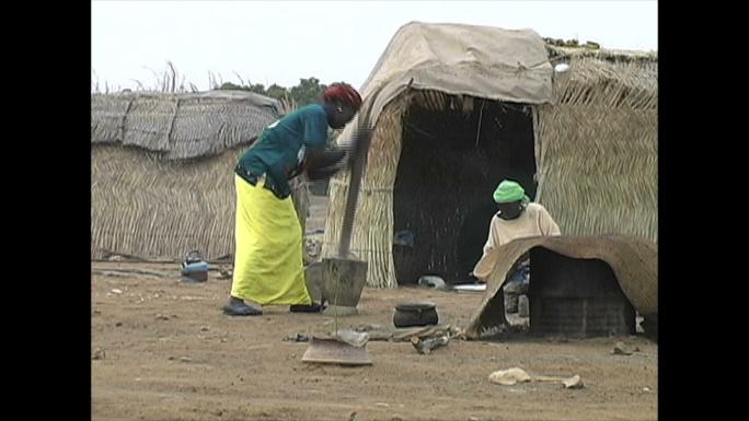 Pounding Grain by Hut Mali