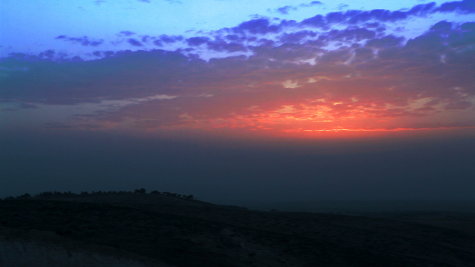 Desert Hill Tops with Vibrant Colored Sunset