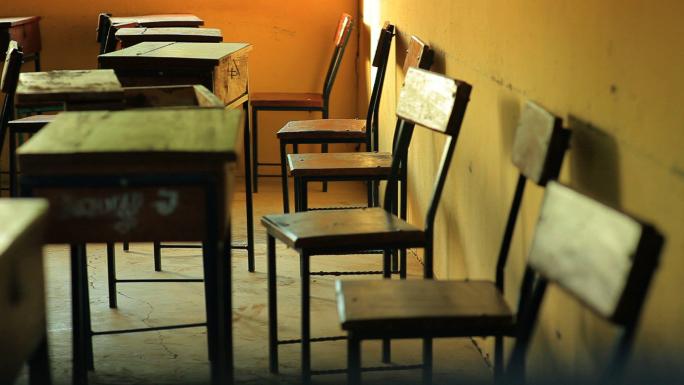 Empty Students Desks in a School in Africa