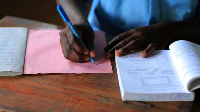 Closeup of Hands Doing Homework