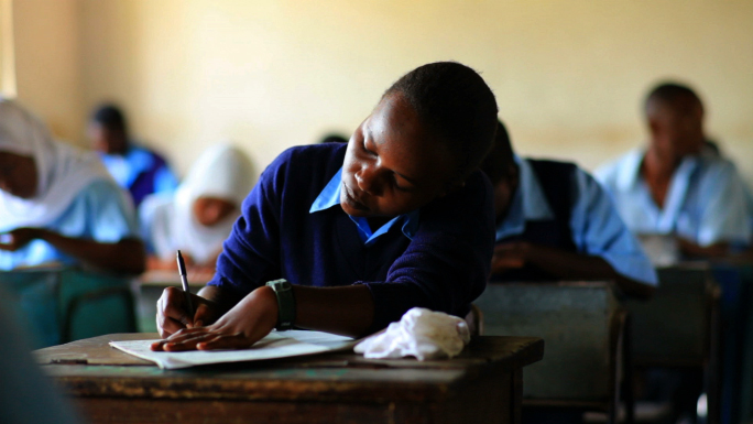 Students Taking a Test in Kenya Classroom 13