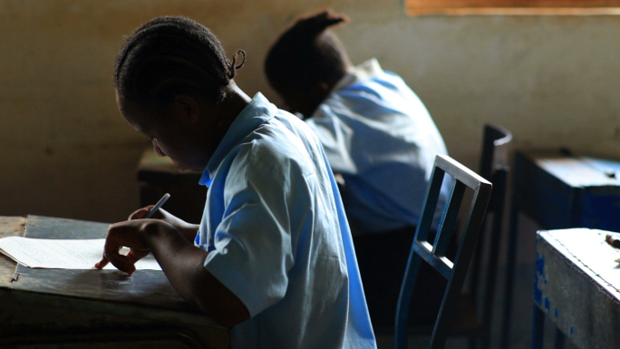 Students Taking a Test in Kenya Classroom 19