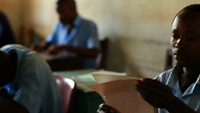 Students Taking a Test in Kenya Classroom 24