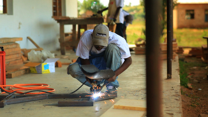 Metal Worker Does Contruction on a Village 5