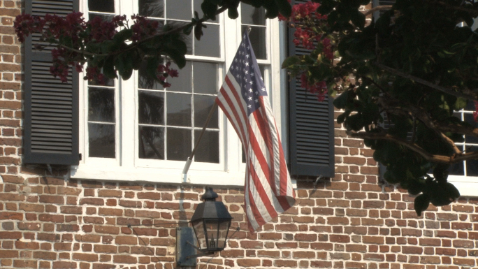 American Flag Hanging from Charleston Home