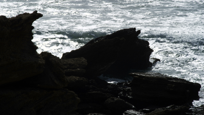Waves Pounding Against Rocks On The Coast