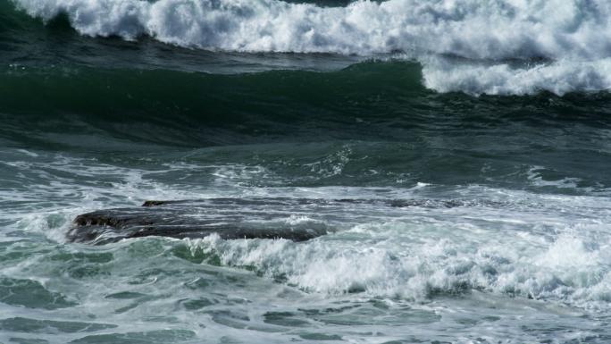 Waves Rolling Over Rocks