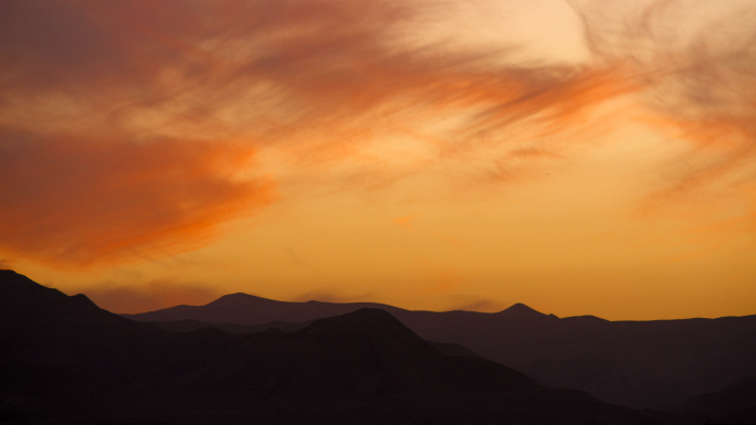 Clouds And Sunset Over Silhouetted Mountains