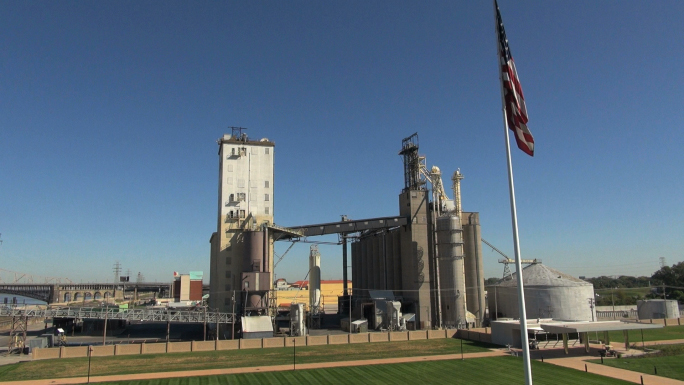 American Flag in Front of Grain Factory