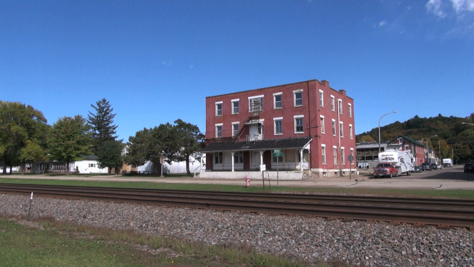 Brick Building in Front of Railroad Tracks 2
