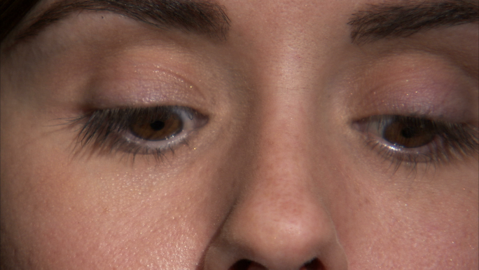 Woman Applying Mascara to Eyes
