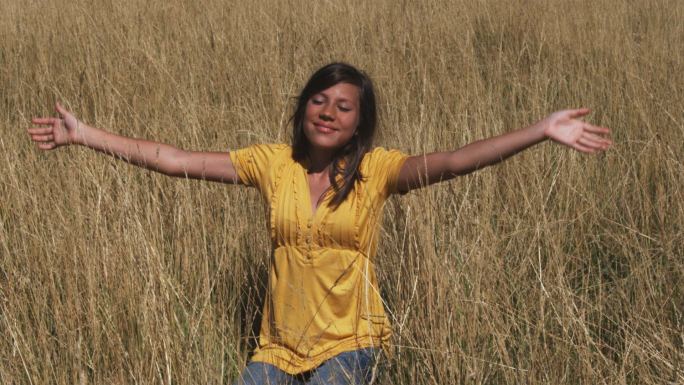 Girl in Yellow Shirt Sits in a Wheat Field 3