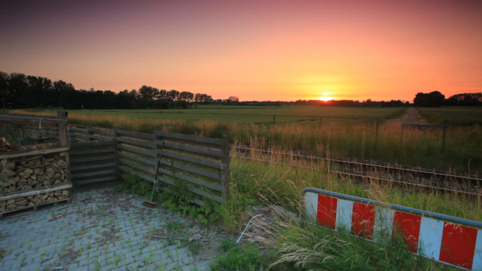 Sunset Over Field in Copenhagen, Denmark