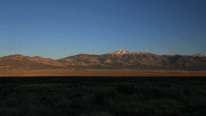 Mountaintop Across Shadowy Plain