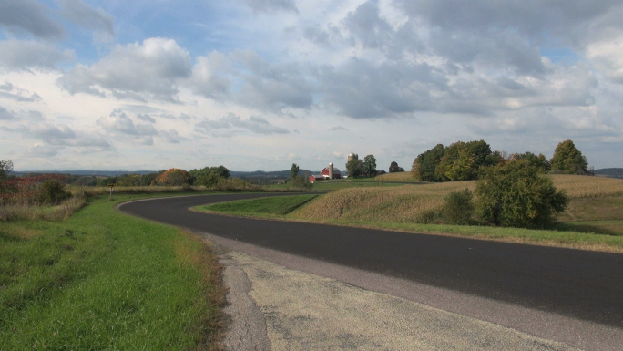 Paved Road Through Open Farmland