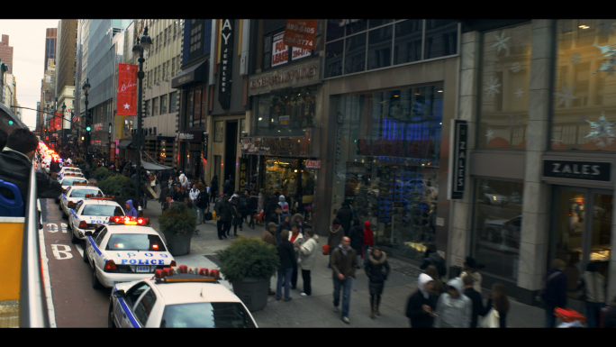 Police Cars and People on West 34th Street in New York